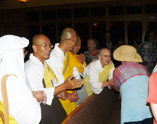 Buddhist monks from the Peace Pagoda in Leverett. Sister Claire is at right.