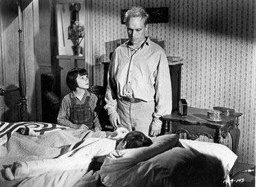 "Robert Duvall as Arthur ""Boo"" Radley with Mary Badham as Mary Louise ""Scout"" Finch and Philip Alford as Jeremy Atticus ""Jem"" Finch"