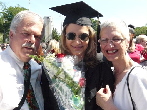 Grad with proud parents