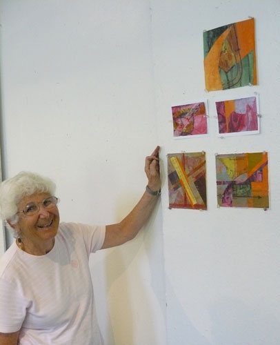 Agnes Maserjian with the collages she made at Snow Farm