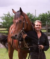 Davy Jones with one of his horses. photo: Palm Beach Post.