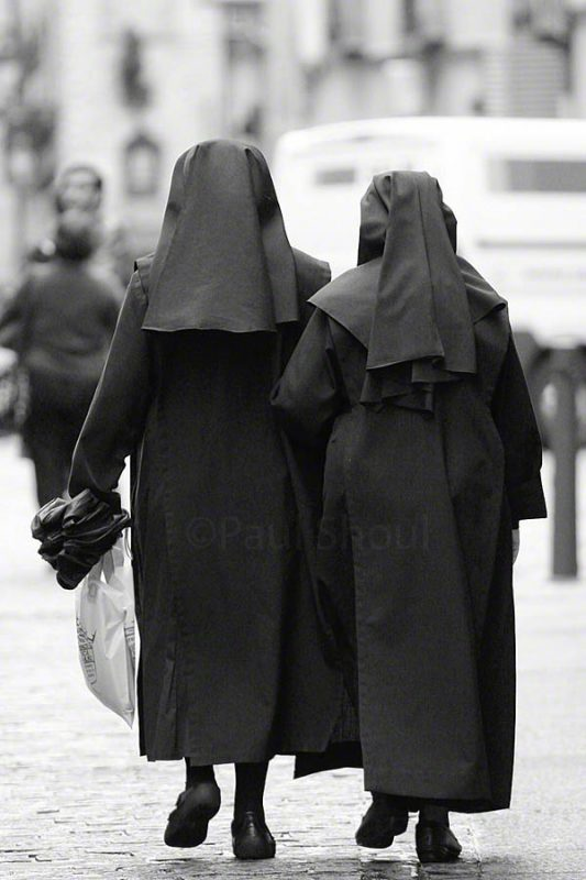nuns walking in Toledo Spain