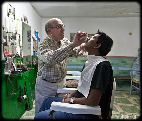 D K Bhaskar getting a trim at the barber Carrasco in Toboso by Rodrigas Manuel