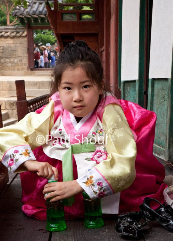 a young girl in traditional costume at Changdeokgung palace in Seoul Soth Korea