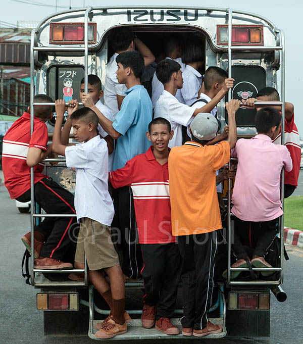 boys packed on a bus on the road in Ayutthaya Thailand