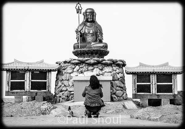 haedong yonggungsa temple south korea a woman prays