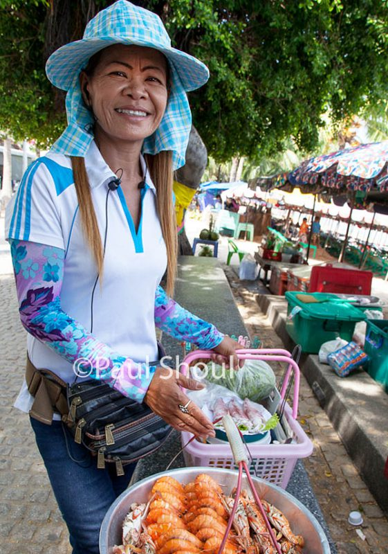 a woman selling  seafood on the beach in Pattaya Thailand