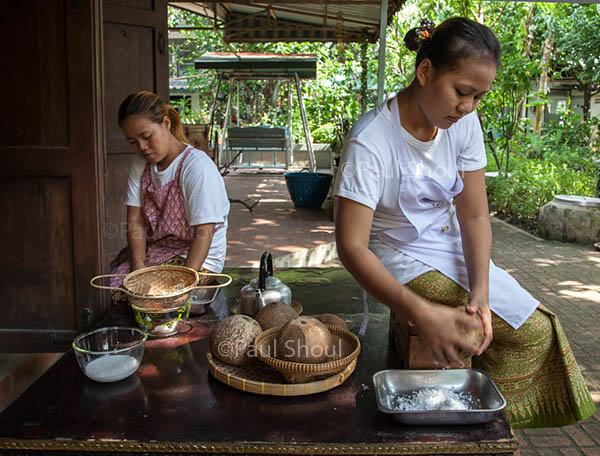 Amita thai cooking bangkok chefs assistants prepare coconuts