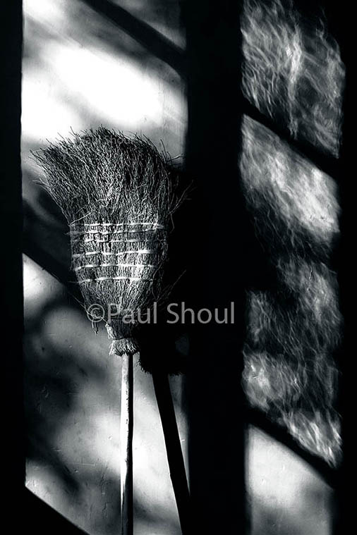 broom in a corner of shadow and light in Guatemala