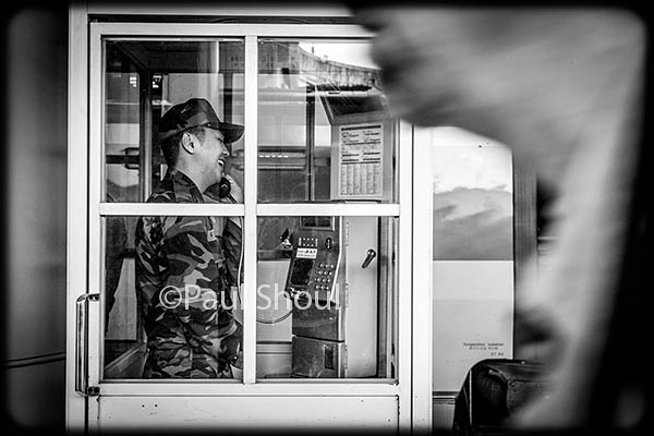 seoul south korean street life a soldier taliking in a phone booth