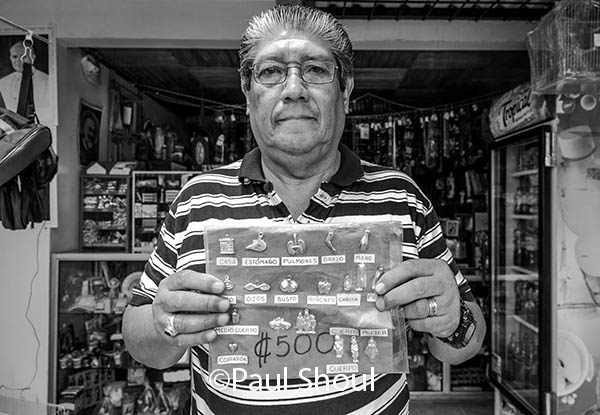 cartago,costa rica shop keeper selling salvadores