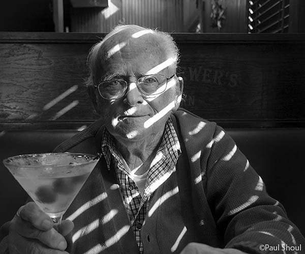 Dr. Melvin I shoul, 90 yrs old, contemplates a large martini