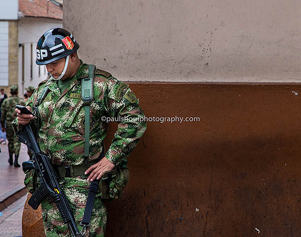 cell phone soldier bogota colombia photo by paul shoul