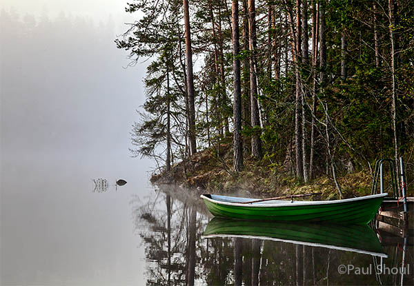 boat in the mist on a lake in finland hawkhill nature