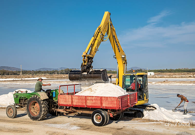 Harvesting Flor de Sal at the Ria Formosa Salt Pans In the Algarve, Portugal.