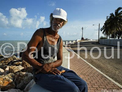 belize-city-portrait of a man by the ocean